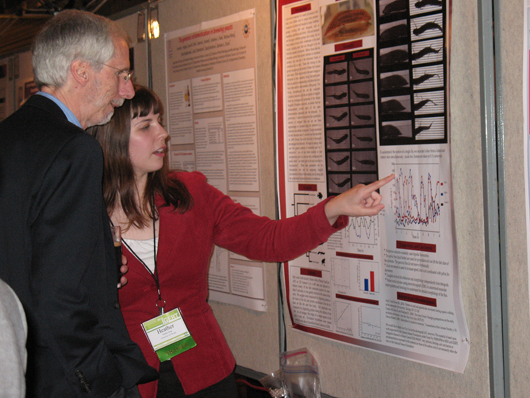 Moto-IGERT Trainee Heather King discussing her research during a poster session at the IGERT Annual Meeting in DC